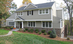 Brown Contemporary transformed into a Craftsman Style with New Windows, Portico, Siding and Stone Base