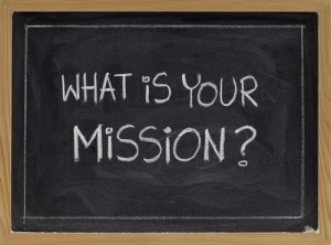 "Blackboard with chalk writing ""What is Your Mission?"""